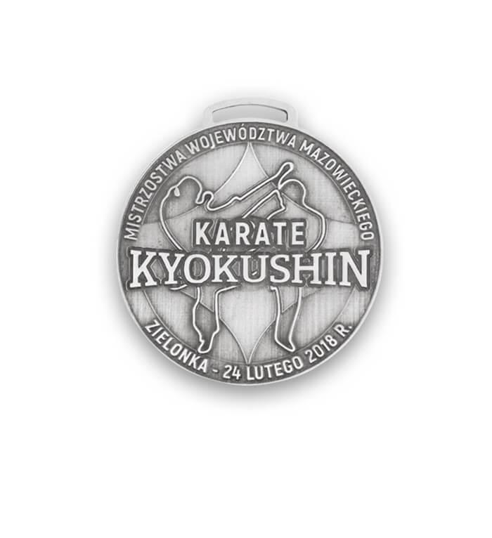Medal sportowy na zawody karate zaprojektowany i wykonany przez firmę MCC Medale