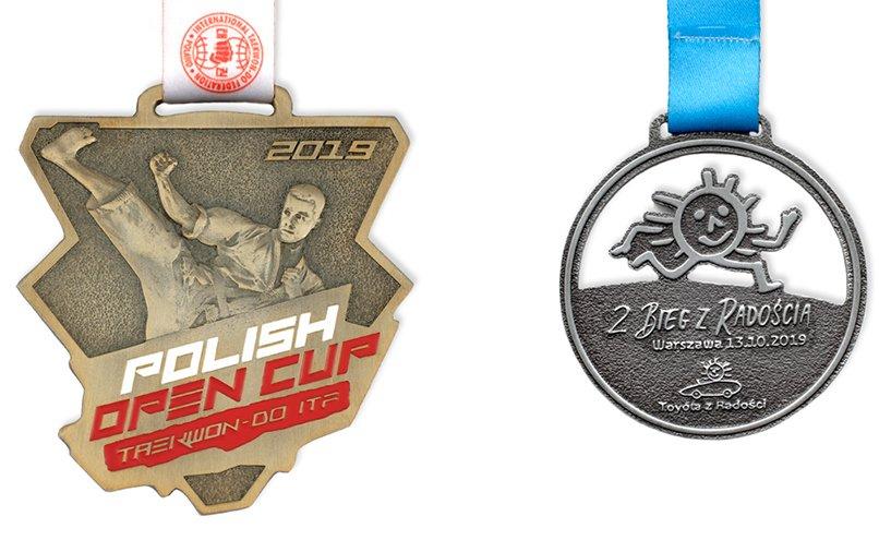 Dwa medale sportowe wykonane w dwóch różnych technikach