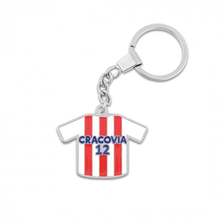 Metalowy brelok z kółkiem w kształcie koszulki klubu Cracovia Kraków z nazwą sponsora oraz numerem zawodnika