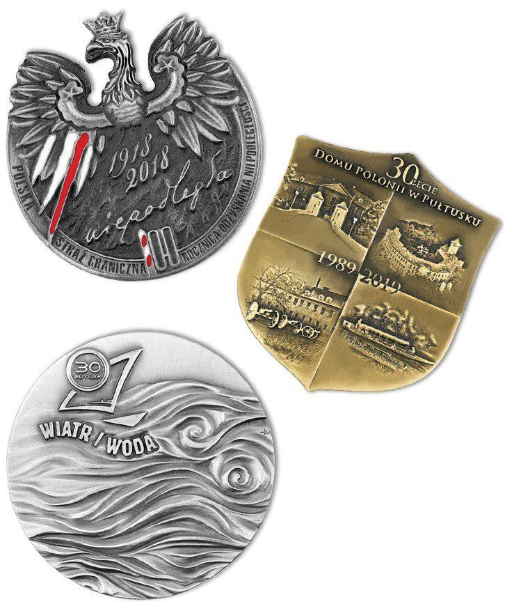 Kompozycja trzech medali okolicznościowych
