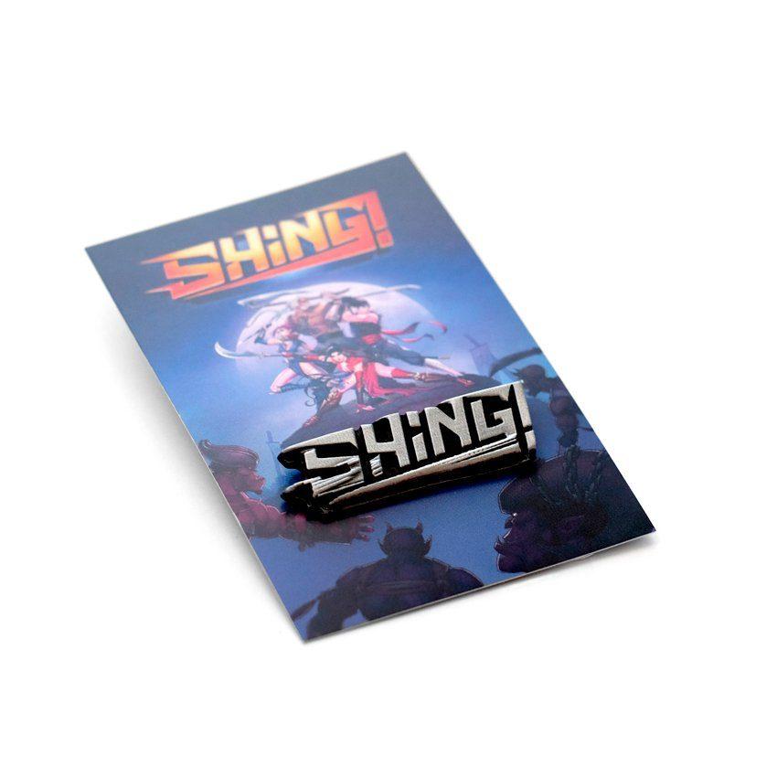 Pins gamingowy umieszczony na dedykowanej karcie z grafiką z gry