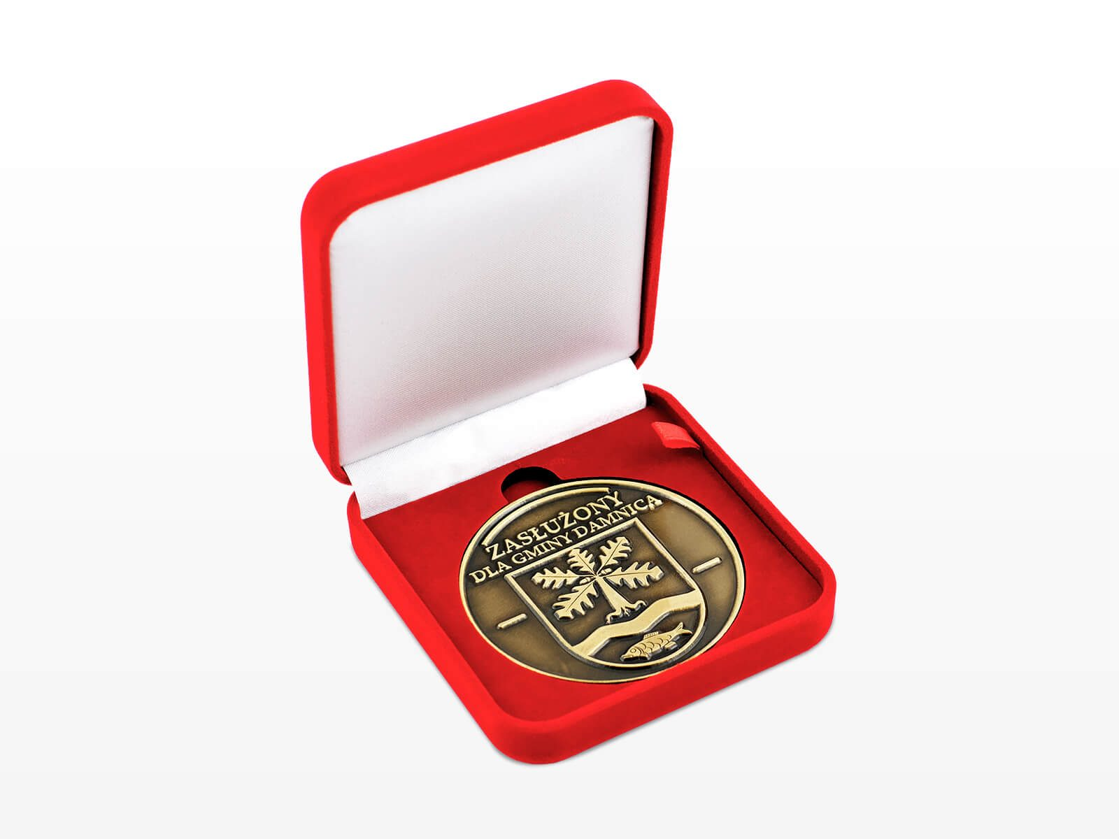 Gminny medal okolicznościowy - zasłuzony dla gminy Damnica w czerwonym etui, wyprodukowany przez MCC Medale