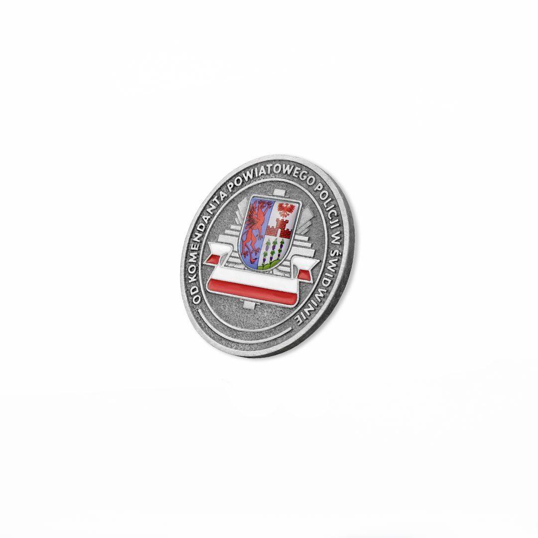 Moneta odlewana z wklejką 3D przedstawiająca kompozycją herbu miejskiego oraz odznaki policyjnej