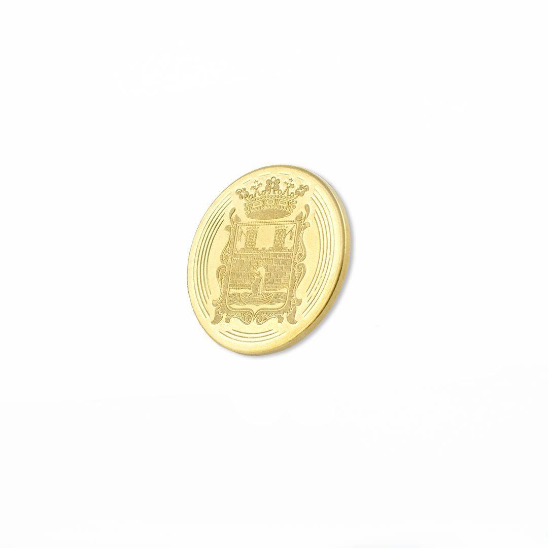 Moneta bita w kolorze złota z motywem herbu miejskiego