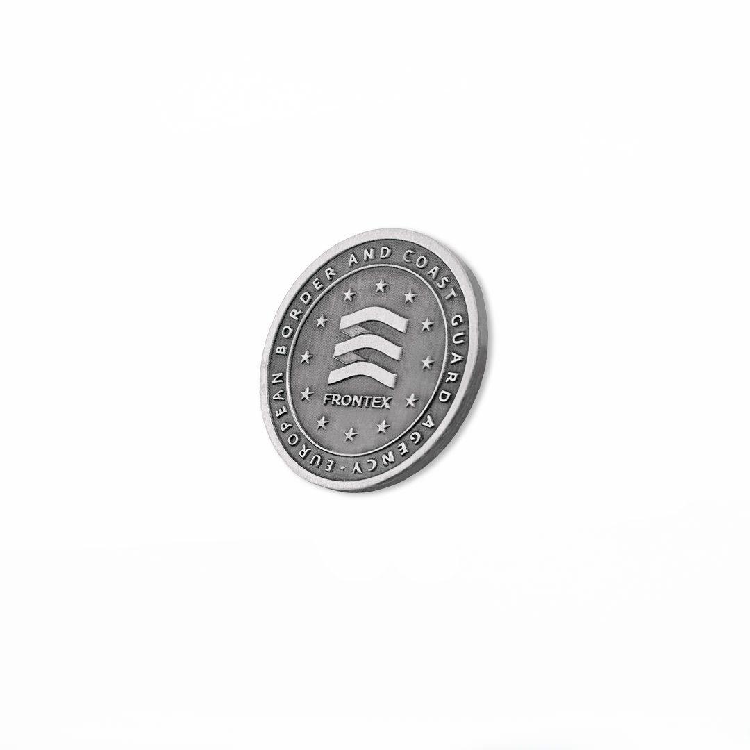 Coin pamiątkowy, jednokolorowy w barwie srebrnej dla agencji Frontex