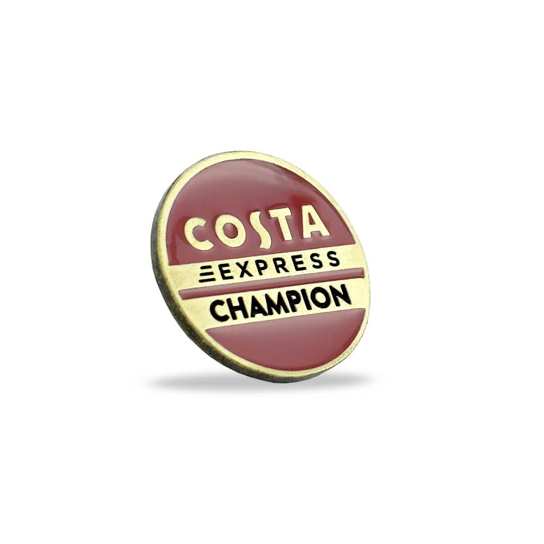 Kolorowa przypinka firmowa Costa Express Champion