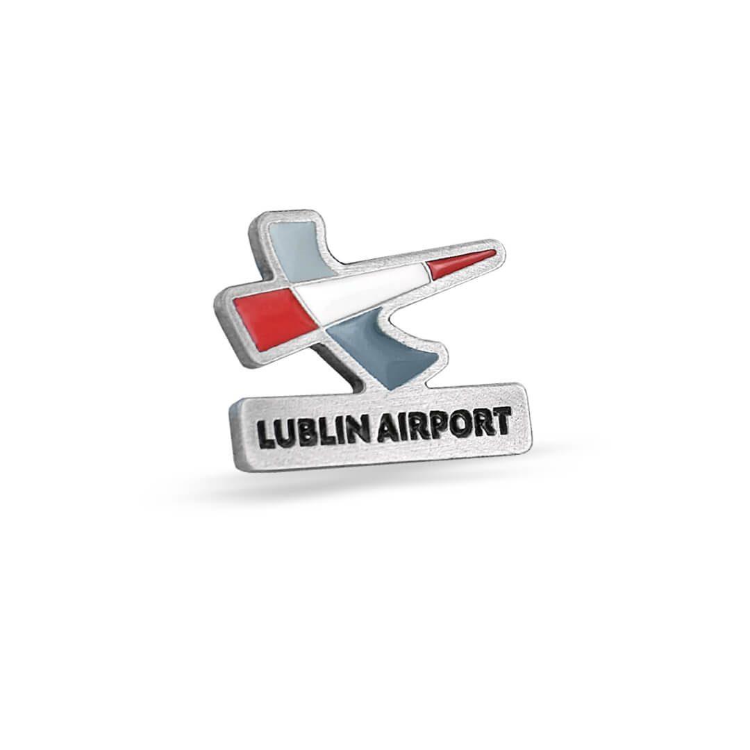 Lotnicza przypinka z logiem, wyprodukowana przez MCC Medale dla Lublin Airport